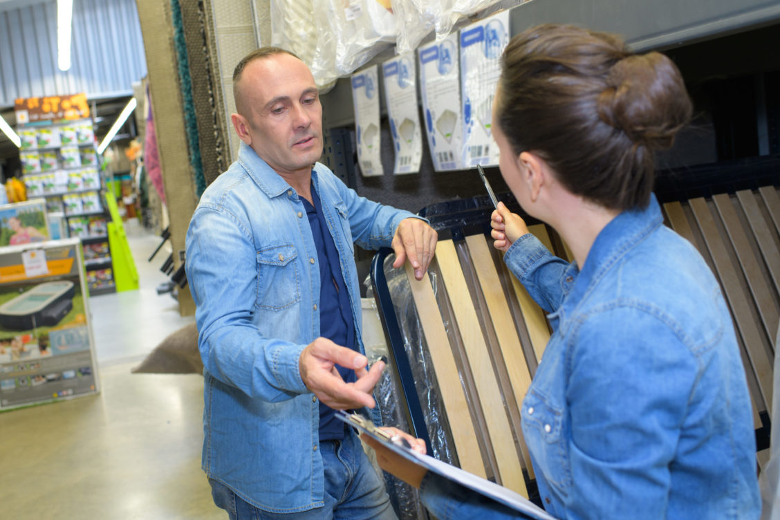 couple shopping parquet in hardware store shop for construction
